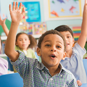 Children in classroom answering questions